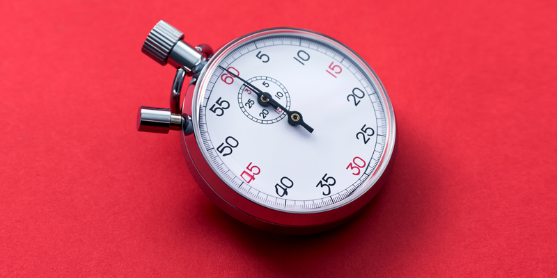 A stopwatch on a red background